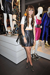 MISCHA BARTON at a party to celebrate the launch of the Matthew Williamson collection at H&M held at the H&M store, Regent Street, London on 22nd April 2009.