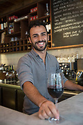 A male waiter at José Tapas Bar on 13th October 2015 along Bermondsey Street in London, United Kingdom.