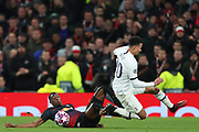 Defender Nordi Mukiele Of Leipzig and Midfielder Dele Alli of Tottenham compete for the ball during the UEFA Champions League match between Tottenham Hotspur and RB Leipzig, at The Tottenham Hotspur Stadium, Thursday, Feb. 20 2020,  in  London, United Kingdom. (Mitchell Gunn/Image of Sport)