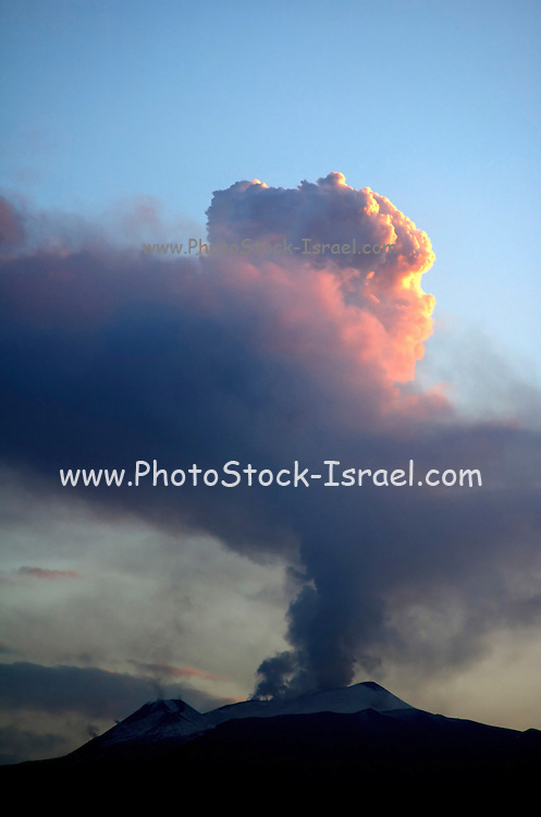 A cloud of steam and smoke irrupting from mount Etna, Sicily, at sun set, July 2006