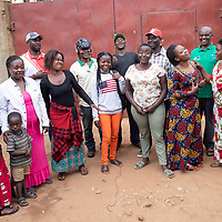 Kakule Masua Eugene (waring a green shirt) heads up a community group to help build a well with support from IMA and Tearfund in Butembo, Congo. Clean drinking water underpins many initiatives for healthcare in  the region.