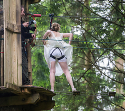 Colette Gregory shows her tailored harness, after tying the knot in the trees at Go Ape Aberfoyle, heading to a zip wire to the climbing net.