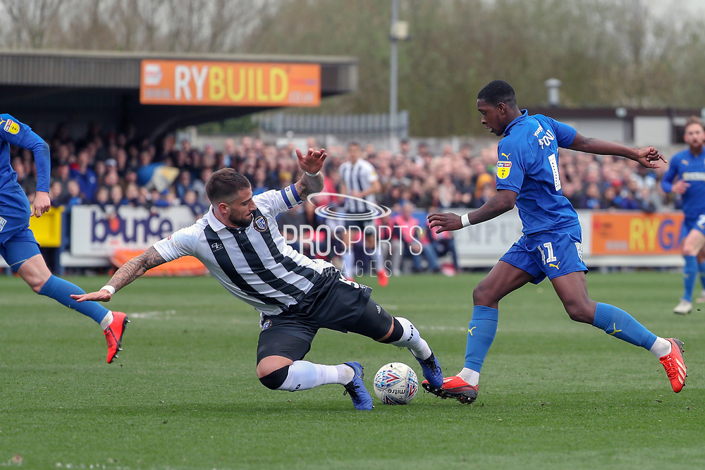 AFC Wimbledon attacker Michael Folivi (41) taking on Gillingham defender Max Ehmer (5) during the EFL Sky Bet League 1 match between AFC Wimbledon and Gillingham at the Cherry Red Records Stadium, Kingston, England on 23 March 2019.