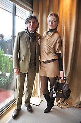 LEON MAX and KATIA ELIZAROVA at the Hennessy Gold Cup at Newbury Racecourse, Berkshire on 26th November 2011.