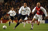 Fotball. UEFA Champions League. 10.12.2002.<br /> Arsenal v Valencia.<br /> Pascal Cygan, Arsenal.<br /> John Carew, Valencia.<br /> Foto: Matthew Impey, Digitalsport