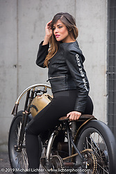 Moisa Silva Marinho models on PDF Motociclette's (Punto Di Fuga) custom 1927 Harley-Davidson JD Racer 1000cc that was on display at Motor Bike Expo. Verona, Italy. January 24, 2016.  Photography ©2016 Michael Lichter.