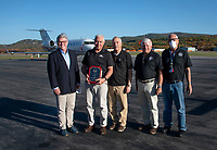 Mayor Andrew Hosmer, Airport Manager Marv Everson, NHPA members David DeVries, Ken Costa and Roger Pascoe award Marv Everson with the Airport Manager of the Year award on Thursday afternoon at the Laconia Airport.  (Karen Bobotas Photo/for The Laconia Daily Sun)