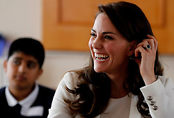 The Duchess of Cambridge reacts as she listens to children during a lesson which focused on plastic in the sea at the 1851 Trust charity's final Land Rover BAR Roadshow at Docklands Sailing and Watersports Centre in London.