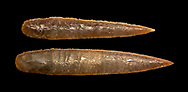 Brown obsidian dagger blades. Catalhoyuk Collections. Museum of Anatolian Civilisations, Ankara. Against a black background .<br /> <br /> If you prefer you can also buy from our ALAMY PHOTO LIBRARY  Collection visit : https://www.alamy.com/portfolio/paul-williams-funkystock/prehistoric-neolithic-art.html - Type Catalhoyuk into the LOWER SEARCH WITHIN GALLERY box. Refine search by adding background colour, place, museum etc.<br /> <br /> Visit our PREHISTORIC PLACES PHOTO COLLECTIONS for more  photos to download or buy as prints https://funkystock.photoshelter.com/gallery-collection/Prehistoric-Neolithic-Sites-Art-Artefacts-Pictures-Photos/C0000tfxw63zrUT4