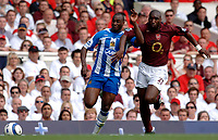 Photo: Daniel Hambury.<br />Arsenal v Wigan Athletic. The Barclays Premiership. 07/05/2006.<br />Arsenal's Sol Campbell and Wigan's Jason Roberts battle.