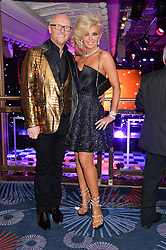 JOHN & CLAIRE CAUDWELL at the Caudwell Children's annual Butterfly Ball held at The Grosvenor House Hotel, Park Lane, London on 15th May 2014.