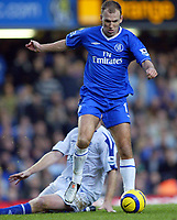 12/5/2004 - Chelsea v  Everton , Stamford Bridge - FA Barclays Premiership.<br />Chelsea's Arjen Robben skips over the challenge from the Everton player<br />Photo:Jed Leicester/Back Page Images