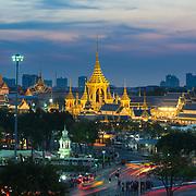 Classic panorama of Bangkok at night - Grand Palace and Sanam luang park golden buddist buildings
