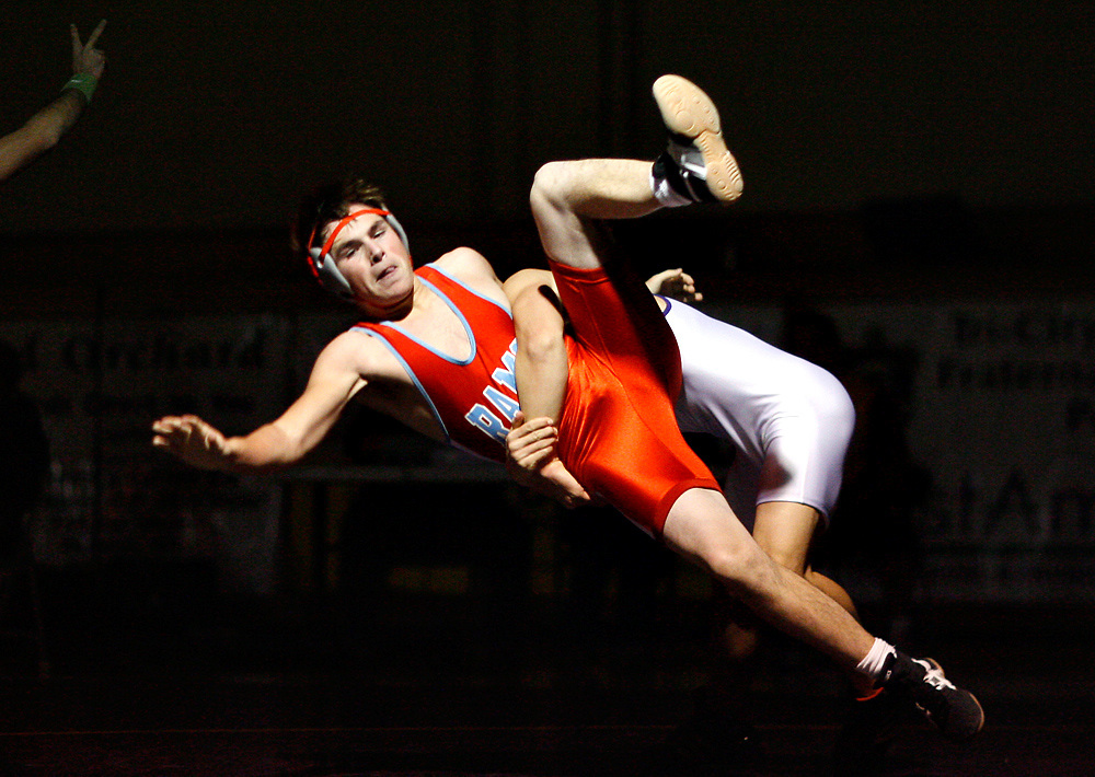 Hanford's Joe Traverso takes down West Valley's Darion Taylor in the 171 pound class as Hanford won 37-35 at home on Dec. 8, 2009.