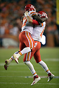 Kansas City Chiefs running back Kareem Hunt (27) leaps and celebrates with Kansas City Chiefs quarterback Patrick Mahomes (15) after Hunt runs for a game winning touchdown that gives the Chiefs a 27-23 lead late in the fourth quarter during the NFL week 4 regular season football game against the Denver Broncos on Monday, Oct. 1, 2018 in Denver. The Chiefs won the game 27-23. (©Paul Anthony Spinelli)