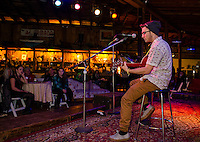 """Bryson Haddock plays his original tune on stage """"A New Pair of Eyes""""  during Laconia High School's Open Mic Coffee House held at Pitman's Freight Room Tuesday evening.  (Karen Bobotas/for the Laconia Daily Sun)"""