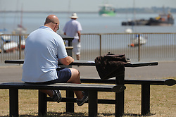 © Licensed to London News Pictures. 15/07/2013<br /> People enjoying the hot heatwave weather today (15.07.2013) on Gordon Promenade in Gravesend, Kent while police and the RNLI search the River Thames for a man that went missing in the water yesterday afternoon.<br />  Photo credit :Grant Falvey/LNP