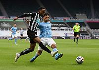 Football - 2020 / 2021 Premier League - Newcastle United vs Manchester City - St James' Park<br /> <br /> Jacob Murphy of Newcastle United vies with Nathan Ake of Manchester City<br /> <br /> Credit : COLORSPORT/BRUCE WHITE