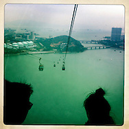 Fellow passengers look out the window of what's part of a three-mile cable car starting on the coast of Hong Kong, and ending on Lantau Island off the coast, where we visited the oldest and tallest Buddha in the world.