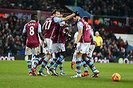 Rudy Gestede of Aston Villa (39) celebrates with his teammates after he scores his teams 1st goal to make it 1-1.Barclays Premier league match, Aston Villa v Leicester city at Villa Park in Birmingham, The Midlands on Saturday 16th January 2016.<br /> pic by Andrew Orchard, Andrew Orchard sports photography.