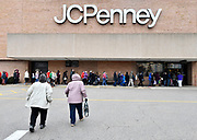 Shoppers enter the JC Penney's store at the St. Clair Square mall in Fairview Heights at 2 pm. Hundreds waited in along line that wrapped around the outside of the building. Shoppers looking for bargains and discounted items endured a light but steady rain on Thanksgiving Day as they waited for stores to open in Fairview Heights, IL on November 28, 2019.<br />  Photo by Tim Vizer