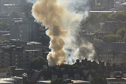 September 29, 2018 - London, London, UK - London, UK.  A large plume of smoke is visible from a fire in Southwark. No further details currently available. (Credit Image: © Guilhem Baker/London News Pictures via ZUMA Wire)