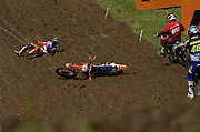 Now this you don't see every day. Dutch rider and MXGP series leader, Jeffrey Herlings, hit the ground Saturday in one of the practice sessions. He was accelerating toward the hill he is laying on, when his rear wheel broke loose and sent him into a high side. It was one of those nasty high-sides where the rider gets pitched over the bars, flying W style. He shook it off and then set the fastest lap time of the session.