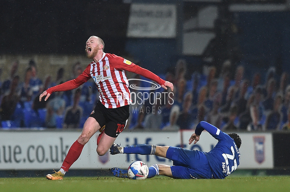 Ipswich Town forward James Norwood (10) fouled by  Sunderland midfielder Grant Leadbitter (23) during the EFL Sky Bet League 1 match between Ipswich Town and Sunderland at Portman Road, Ipswich, England on 26 January 2021.