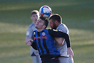Conor Shaughnessy of Rochdale and Michael Bostwick of Burton Albion  contest an aerial ball  during the EFL Sky Bet League 1 match between Rochdale and Burton Albion at the Crown Oil Arena, Rochdale, England on 27 February 2021.