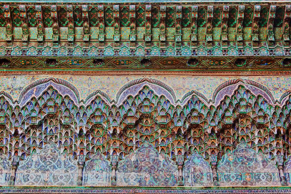 Colorful painted wood carvings inside the Kasbah Telouet in Morocco.
