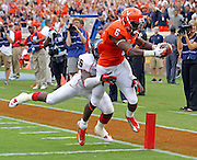 Virginia Cavaliers wide receiver Darius Jennings (6) scores a touchdown despite efforts from Richmond Spiders defensive back Darryl Hamilton (26) during the first half of the NCAA football game Saturday September, 1, 2012 at Scott Stadium in Charlottesville, Va.