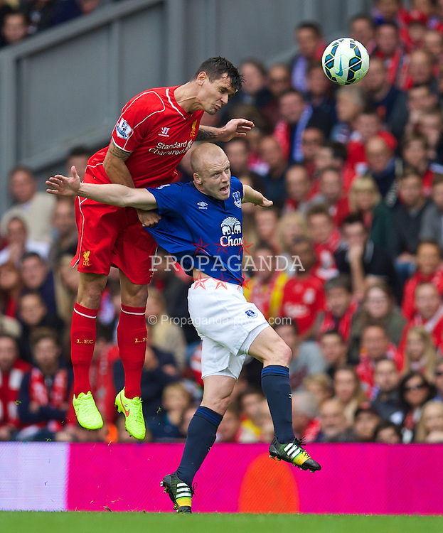 LIVERPOOL, ENGLAND - Friday, September 26, 2014: Liverpool's Dejan Lovren and Everton's Steven Naismith during the Premier League match at Anfield. (Pic by David Rawcliffe/Propaganda)
