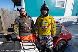 Moscow motorcycle mechanic Alexander Pikalo and Batrak Alexey upon arriving after their 10,000 km ride from Moscow through Siberia in winter on their Honda Silver Wing scooters for the Baikal Mile Ice Speed Festival. Maksimiha, Siberia, Russia. Tuesday, February 25, 2020. Photography ©2020 Michael Lichter.