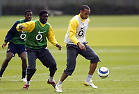 Photo: Chris Ratcliffe.<br />Arsenal Training Session. UEFA Champions League. 18/04/2006.<br />Thierry Henry is closed down by Kolo Toure during training