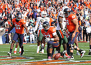 Oct 30, 2010; Charlottesville, VA, USA;   Virginia Cavaliers running back Keith Payne (22) scores his second touchdown surrounded by Virginia Cavaliers wide receiver Dontrelle Inman (81) and Virginia Cavaliers center Anthony Mihota (68) during the game at Scott Stadium. Virginia won 24-19. Mandatory Credit: Andrew Shurtleff