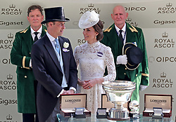 The Duke and Duchess of Cambridge present a trophy to the winner of the King's Stand Stakes during day one of Royal Ascot at Ascot Racecourse.
