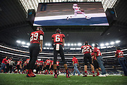 The Iraan High School football team look on during the state championship game at AT&T Stadium in Arlington, Texas on December 15, 2016. (Cooper Neill for The New York Times)