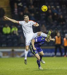 Raith Rovers Louis Longridge and Hibernian's David Gray. <br /> Raith Rovers 2 v 1 Hibernian, Scottish Championship game player at Stark's Park, 18/3/2016.