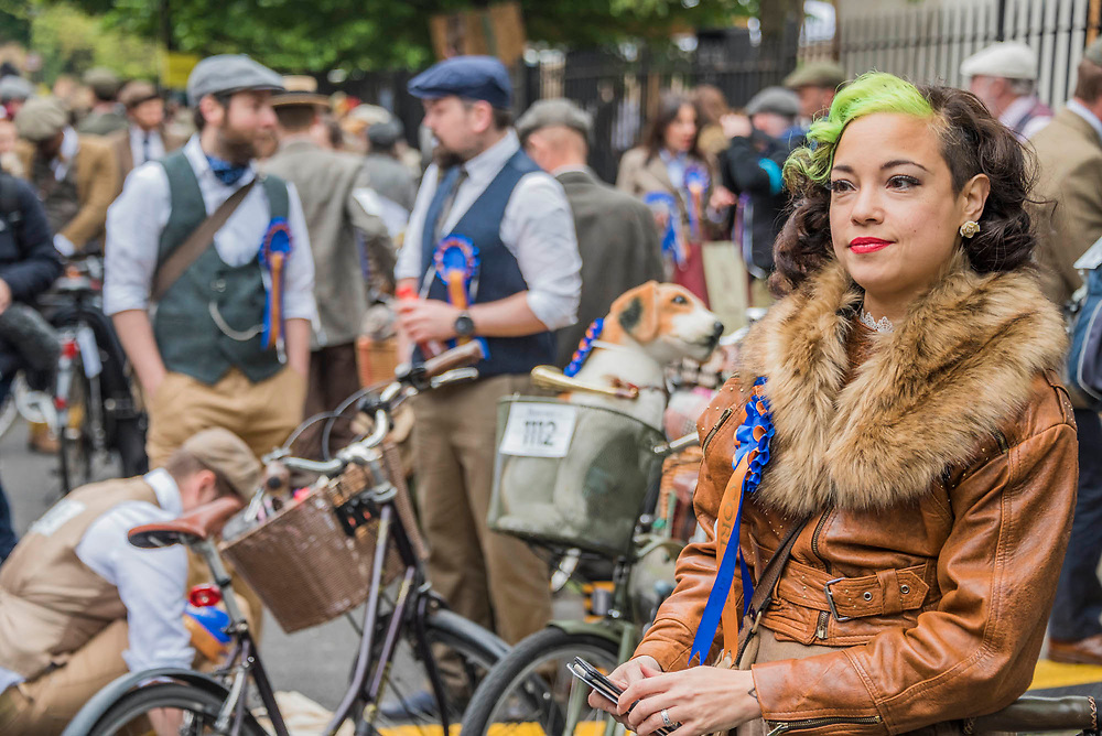 """The Tweed Run - a group bicycle ride through the centre of London, in which the cyclists are expected to dress in traditional British cycling attire, particularly tweed plus four suits. Any bicycle is acceptable on the Tweed Run, but classic vintage bicycles are encouraged in an effort to recreate the spirit of a bygone era. The ride dubs itself """"A Metropolitan Cycle Ride With a Bit of Style."""" London 06 May 2017"""