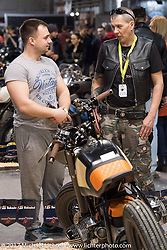 Checking out the bikes in the Custom and Tuning Show, the custom bike show portion of the big Motor Spring bike show in Moscow, Russia. Sunday April 23, 2017. Photography ©2017 Michael Lichter.