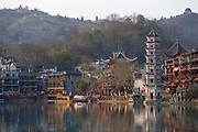 View of a river and the architecture in an ancient Chinese town, Fenghuang, Hunan Province, China