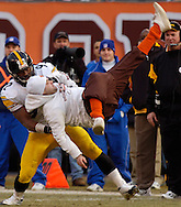 A fan at the Pittsburgh at Cleveland game December 24, 2005 is slammed to the ground by the Steelers' James Harrison after the fan ran onto the field at Cleveland Browns Stadium during the game.