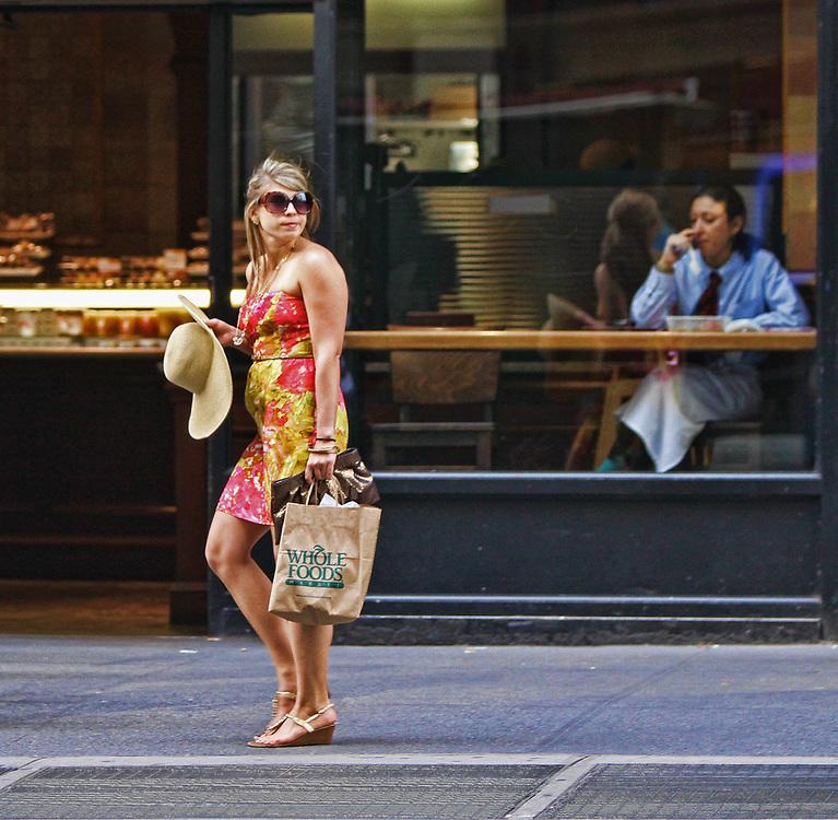 Stylish New York girl and female restaurant server at break. NYC 2010