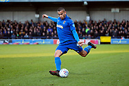 AFC Wimbledon defender Rod McDonald (4) passing the ball during the EFL Sky Bet League 1 match between AFC Wimbledon and Fleetwood Town at the Cherry Red Records Stadium, Kingston, England on 8 February 2020.