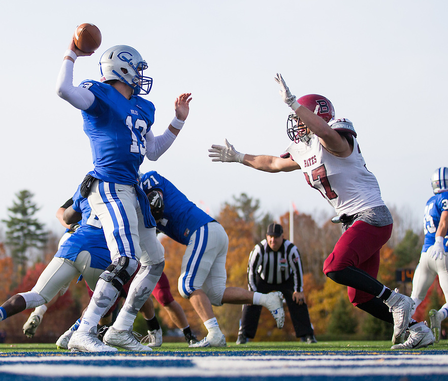 Colby College quarterback Gabe Harrington (13) throws a pass while being pressured by Bates College linebacker Max Breschi (47) during a NCAA Division III football game between Colby College and Bates College at Seaverns Field at Harold Alfond Stadium on October 24, 2015 in Waterville, Maine. (Dustin Satloff)