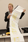 """Rape Survivor and activist, Catherine """"Jane"""" Fisher shows a 6 metre long list of sexual crimes against women that have taken place in Okinawa since 1945 at a press conference to publicise her book in the First Office Building of the Members of the House of Representatives, Nagatacho, Tokyo, Japan, Friday July 18th 2014. Ms Fisher was raped near Yokosuka US Naval Base in Kanagawa in 2002 and has been campaign for the rights of rape victims in Japan since after finding the US Military and Japanese police obstructive and uninterested in bringing her attacker to justice."""