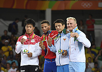 Bryting 14. august 2016 , (160814) -- RIO DE JANEIRO, Aug. 14, 2016 -- Ismael Borrero Molina of Cuba (2nd L), Shinobu Ota of Japan (1st L), Elmurat Tasmuradov of Uzbekistan (2nd R) and Stig-Andre Berge of Norway attend the awarding ceremony of the men s Greco-Roman 59kg of Wrestling at the 2016 Rio Olympic Games Olympische Spiele Olympia OS in Rio de Janeiro, Brazil, on Aug. 14, 2016. Ismael Borrero Molina won the gold medal. )(dh)<br /> <br /> Norway only