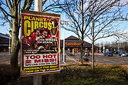An advert sign for traveling show Planet Circus on a post in the car park of Sainsbury's supermarket in central Middlesborough, England, UK.