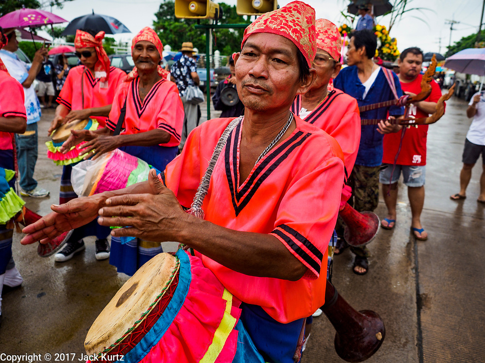 04 OCTOBER 2017 - CHONBURI, CHONBURI, THAILAND: Traditional drummers perform in the parade before the water buffalo races. Contestants race water buffalo about 100 meters down a muddy straight away. The buffalo races in Chonburi first took place in 1912 for Thai King Rama VI. Now the races have evolved into a festival that marks the end of Buddhist Lent and is held on the first full moon of the 11th lunar month (either October or November). Thousands of people come to Chonburi, about 90 minutes from Bangkok, for the races and carnival midway.   PHOTO BY JACK KURTZ