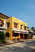Street scene along Kingkitsarath Road, Luang Prabang, Laos.